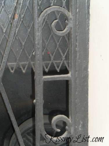 "Look for the ""E"" in this photo of an iron door frame."